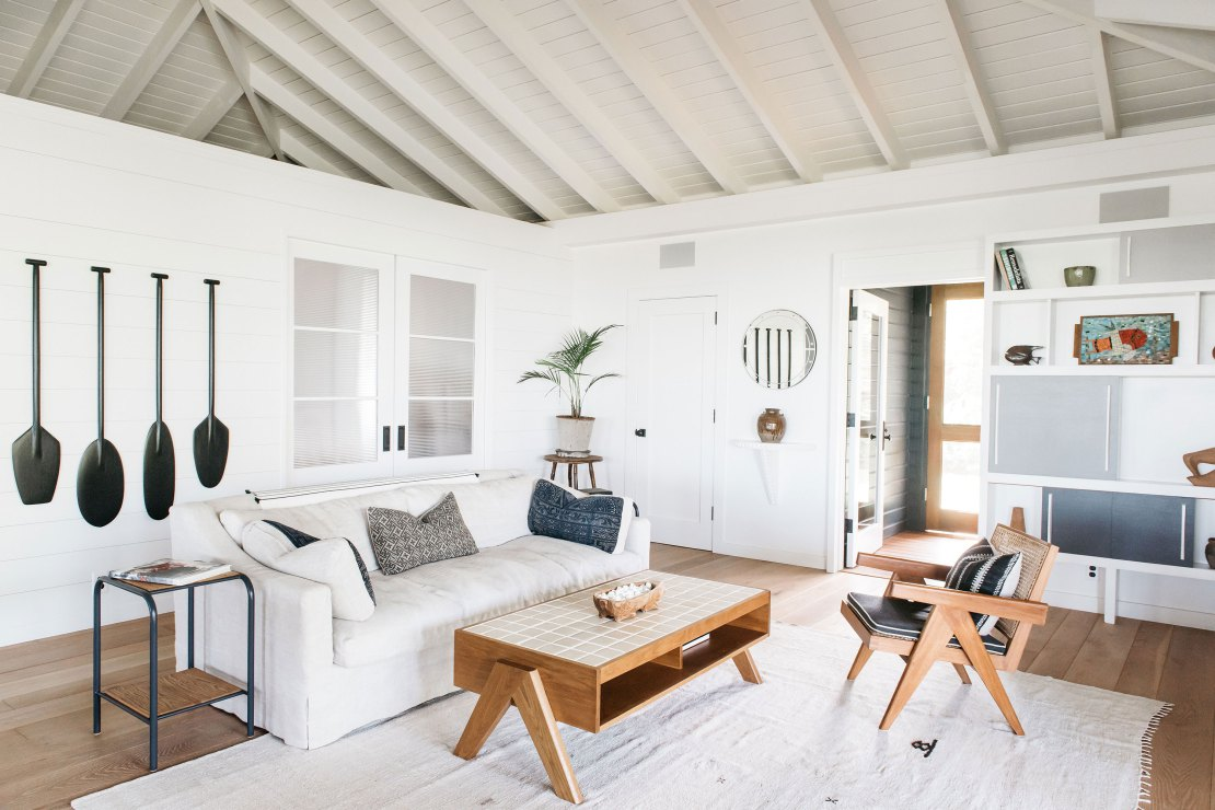 Gorgeous white cottage style living room with exposed rafters in Maui Beach house - seen on Hello Lovely Studio