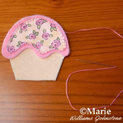 Sewing needle, embroidery floss and sewing an edge stitch by hand