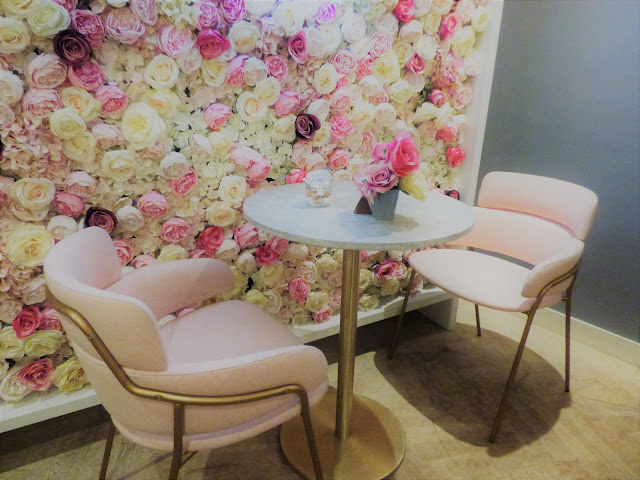 Pink flower wall at Elan Cafe, Park Lane, London