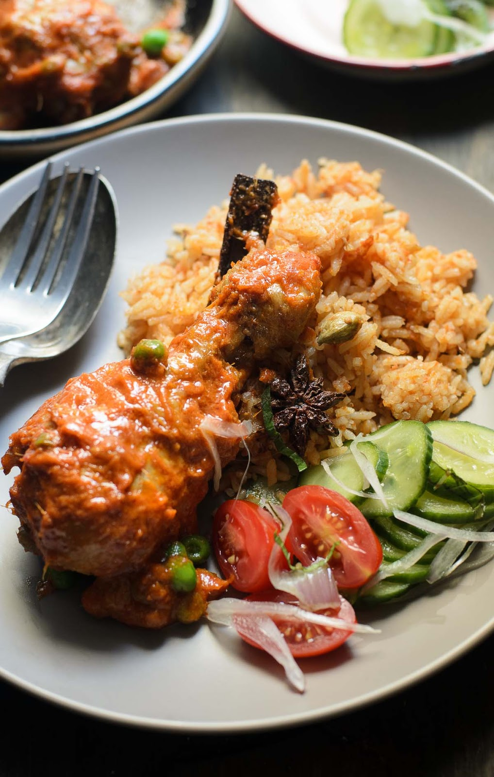 Chicken in Spiced tomato sauce serve with tomato rice
