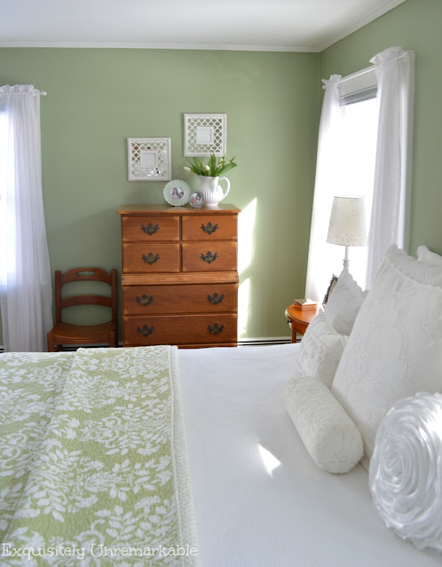 Cottage Style Bedroom with green walls and green quilted bedding