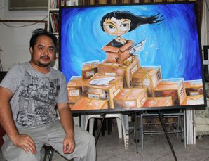 "Blogger George Pontino, Jr. with his acrylic on canvas painting entitled ""Balikbayan Box"""