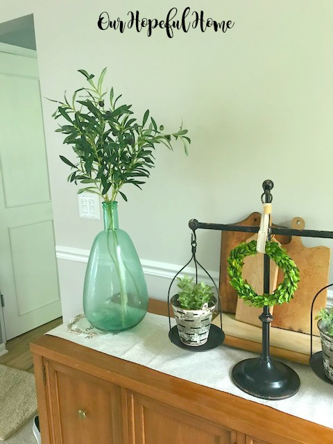 farmhouse dining room demijohn olive branches balance scale olive bucket cutting boards boxwood wreaths