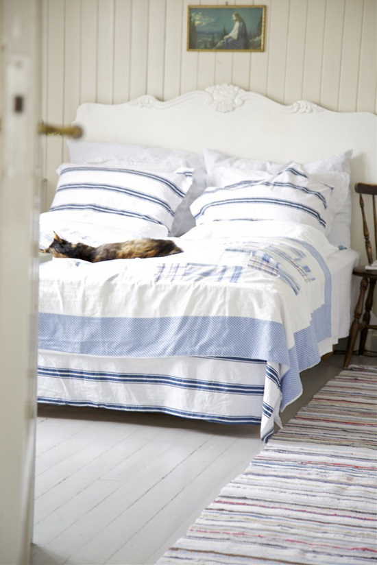 Stripe bed linens and shabby coastal decor