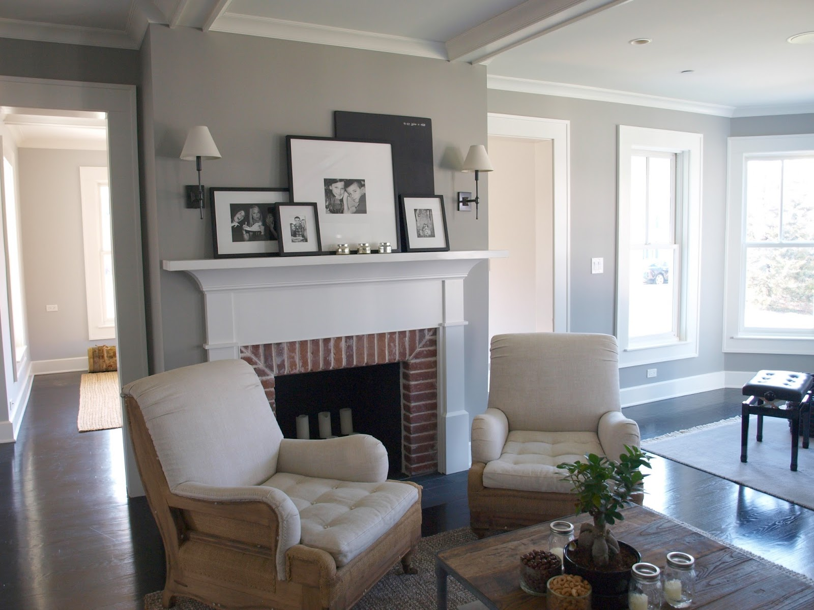 Modern farmhouse living room with grey walls and red brick fireplace - Hello Lovely Studio