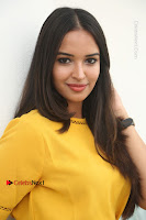 Actress Poojitha Stills in Yellow Short Dress at Darshakudu Movie Teaser Launch .COM 0154.JPG