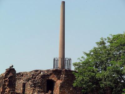 The Asoka Pillar on top of a three-storey building