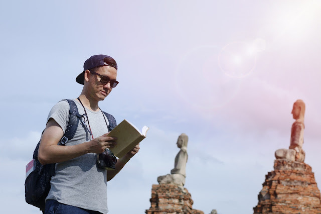 Young man traveling through Asia, language learning