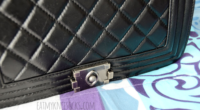 Details on the black Ingrid quilted medium leather bag from BagInc, an elegant, stylish, luxurious designer-inspired purse that features real-leather quilted detailing, vintage antique metal hardware, a chain shoulder strap, and more!