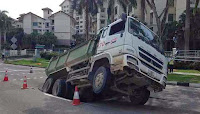 http://sciencythoughts.blogspot.co.uk/2014/04/truck-swallowed-by-singapore-sinkhole.html