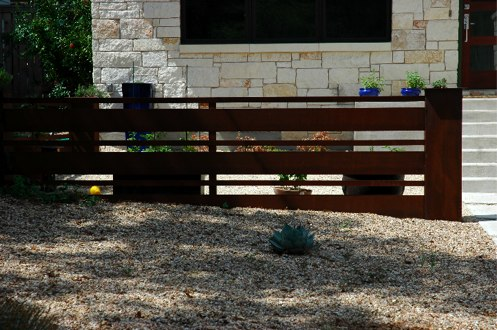 Fencing ideas for the backyard that use cedar, steel, gabion for inspiration.