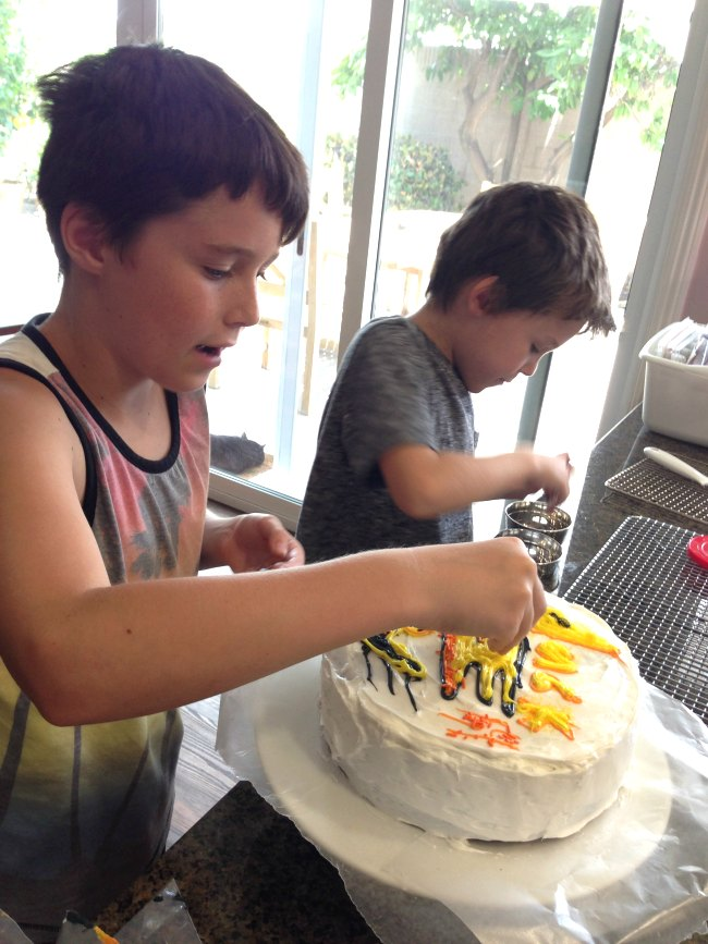 Kids decorating a cake