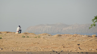 People like to sit on stones and watch in the ocean of Africa