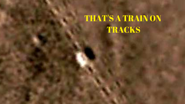 That is most definitely a train on it's own tracks but it's on Mars.