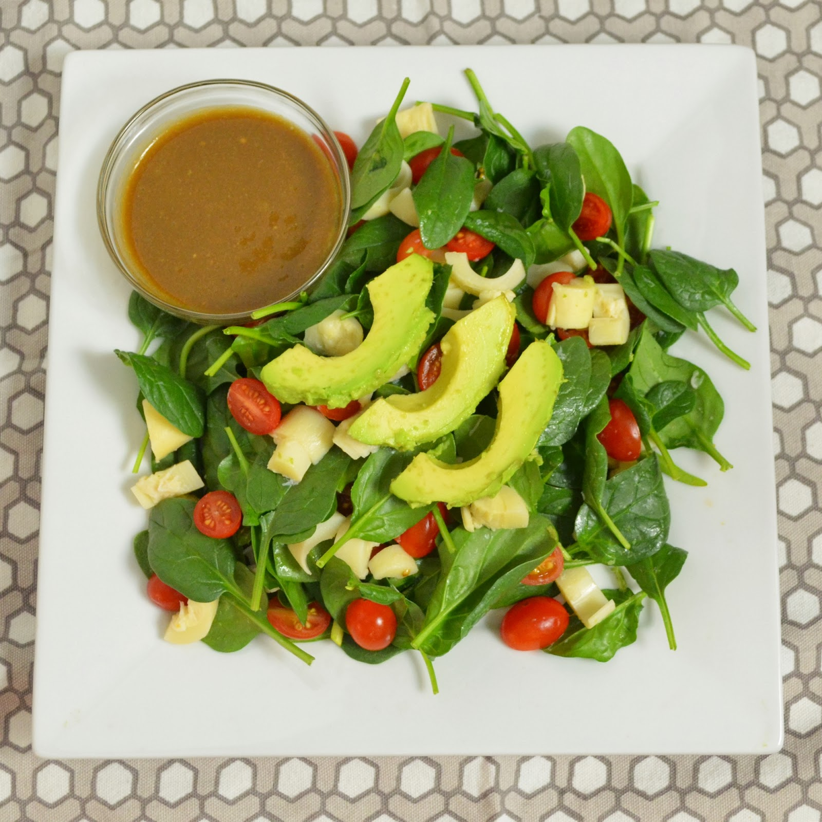 Spinach Salad with Tomatoes, Avocado, and Hearts of Palm