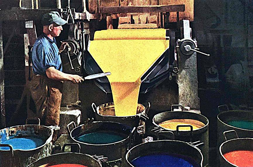 a 1948 paint factory, color photograph of yellow paint pouring