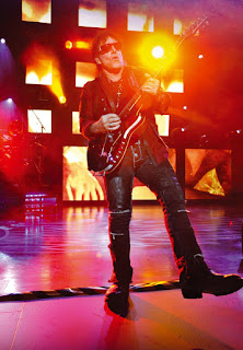 Neal Schon plays the guitar
