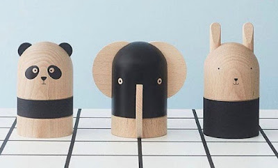 three wood piggy banks: a panda, an elephants, and a rabbit