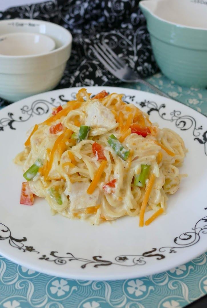 Cheesy Chicken and Asparagus Spaghetti Casserole Recipe! This creamy angel hair pasta bake is a great way to use leftover rotisserie chicken! It's budget friendly and the whole family will love it!