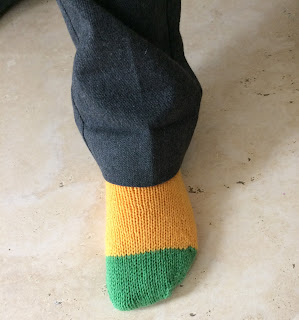 Wearing yellow and green hand-knit socks