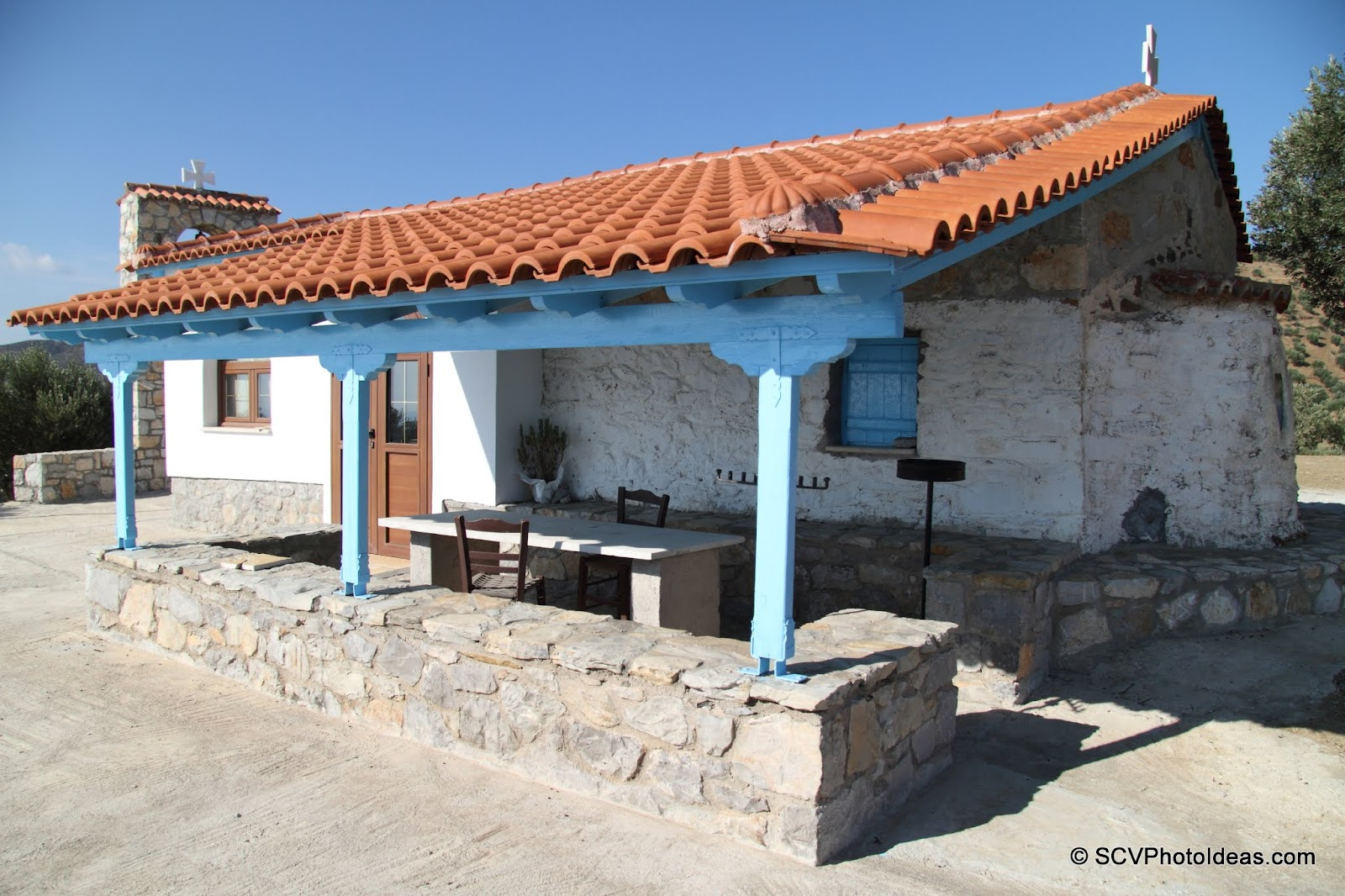 Ag. Nikolaos front yard shade showing 17th century walls