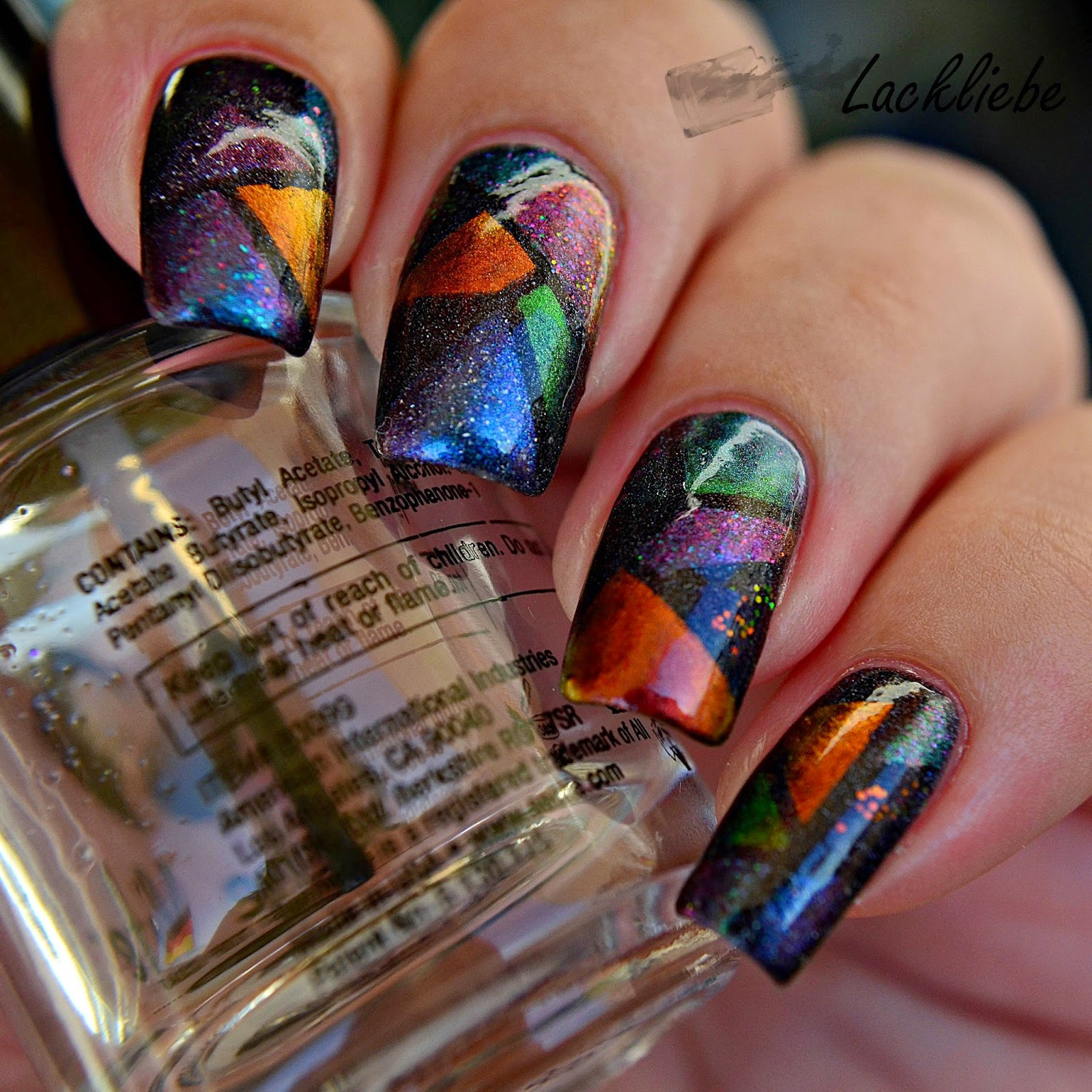 http://rainpow-nails.blogspot.de/2014/08/tape-month-magic-mosaic.html
