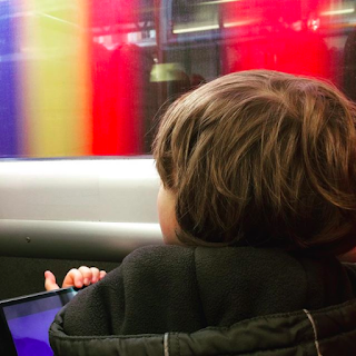 Boy with autism on a colourful train