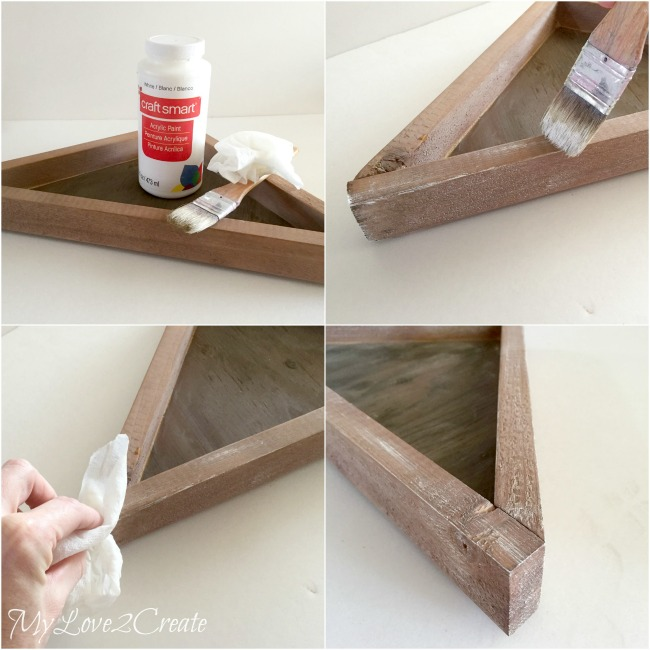 adding textured look to natural stained tray with white paint and chip brush