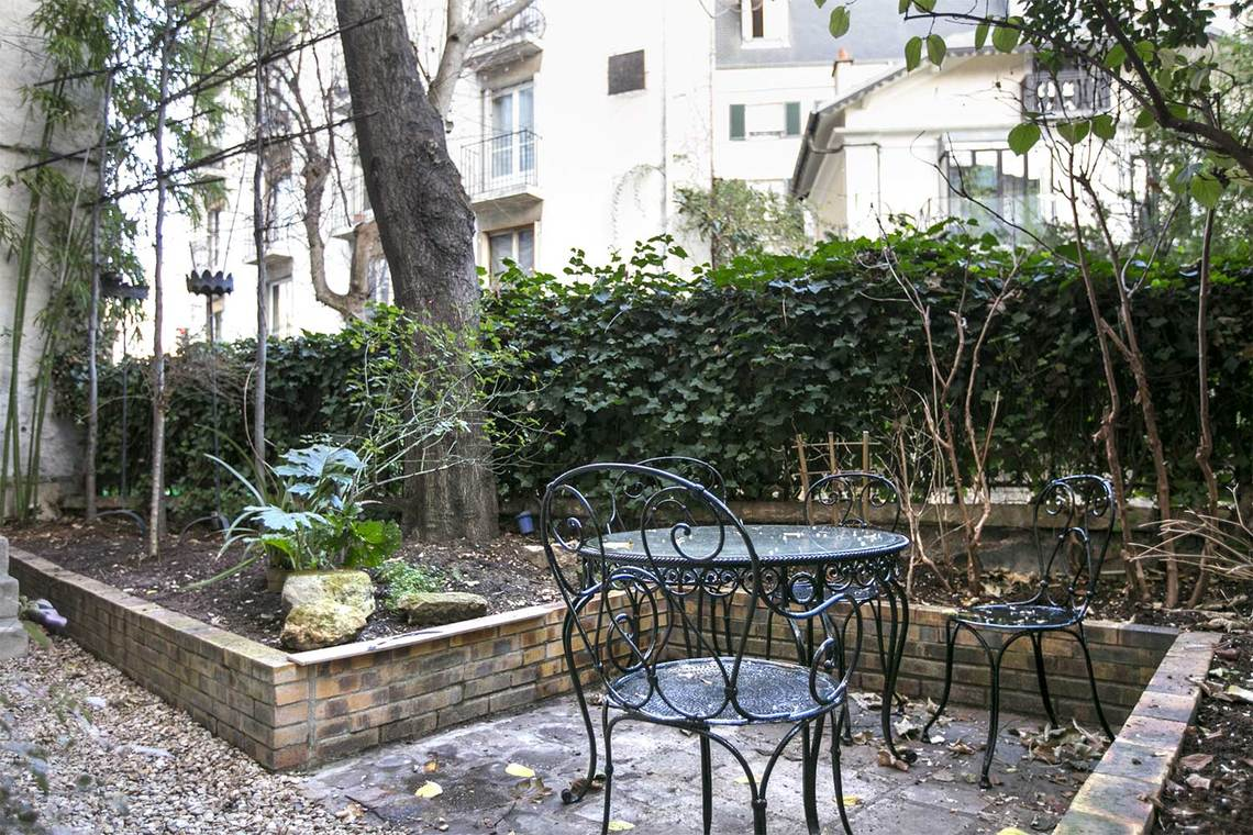 Bistro set in private garden on secret Avenue Frochot in Paris seen on Hello Lovely Studio