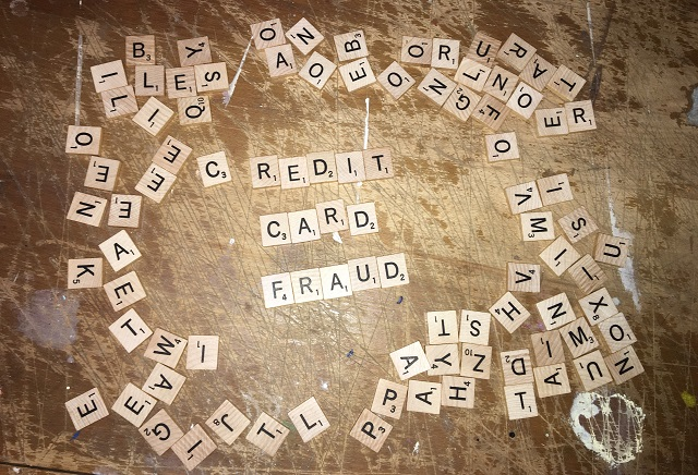 Credit Card Fraud spelled out using Scrabble tiles
