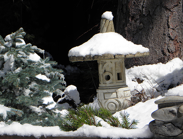 Decorative Pagoda and Shrubs covered with Snow