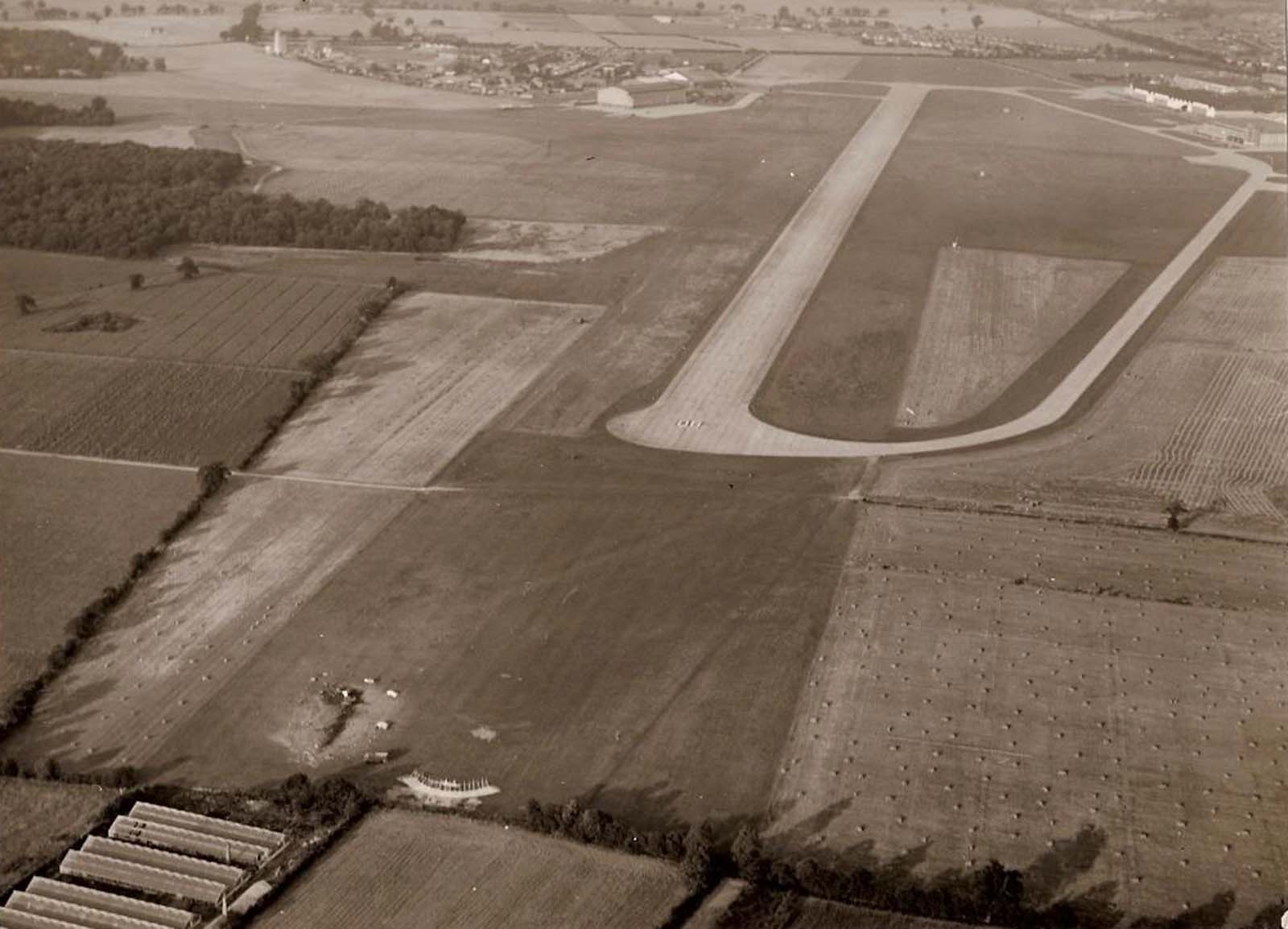 The wreckage of the Lightning can be seen above just on the airfield short of the runway and just beyond the greenhouses in which George landed.