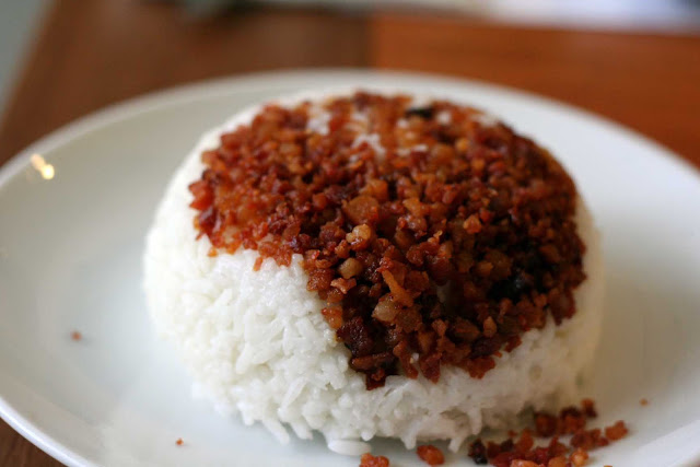 Rice topped with bacon bits