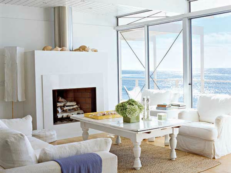 white slipcover sofa and chairs with shabby chic coastal touches and ocean view
