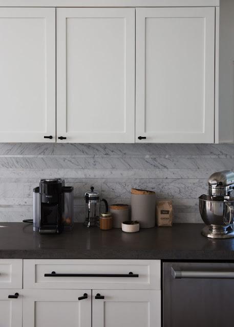 Marble backsplash dark counters white kitchen cabinets Brendon Urie kitchen