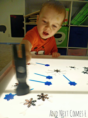 K hammering snowflakes on the light table from And Next Comes L