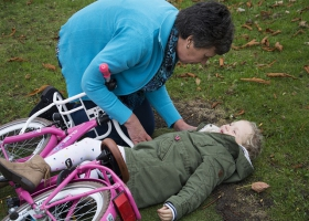 A mother first-aids her child after a bicycle accident.