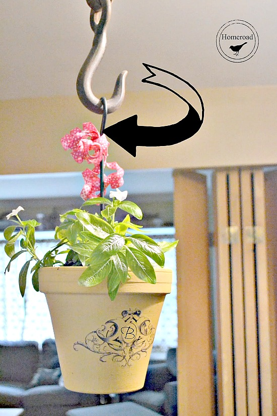 Wrought Iron Hanging Planter with a transfer