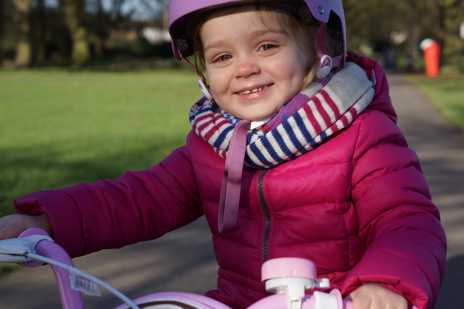 little girl with a bike helmet