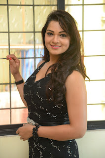 Actress Ashwini Stills in Black Dress at DJ Lemon Holi Poster Launch  0020