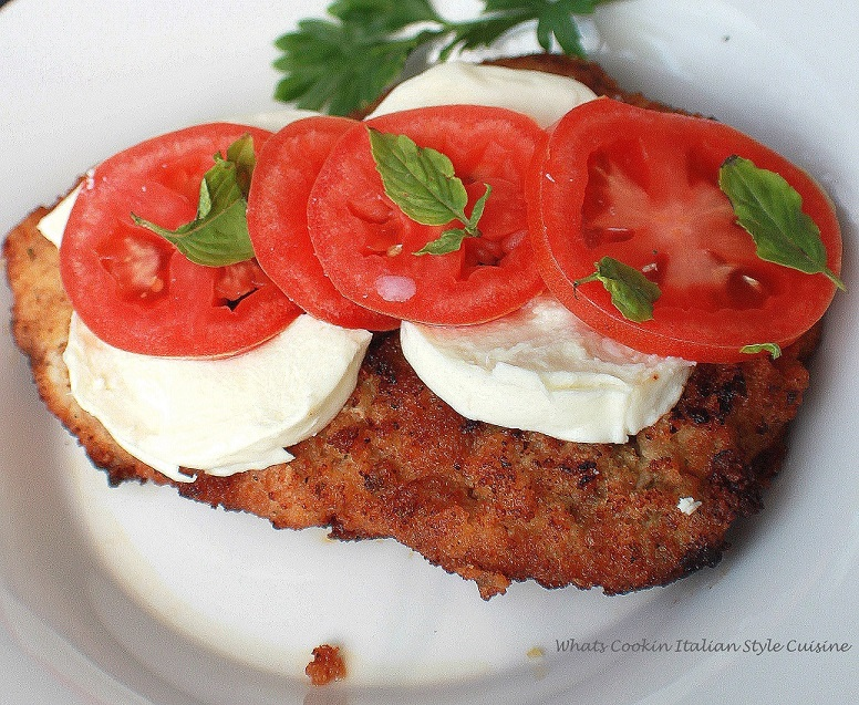Fried steak cutlets with mozzarella, fresh basil and tomatoes v