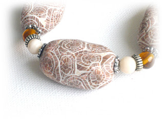 Beige seashell print bracelet created from polymer clay