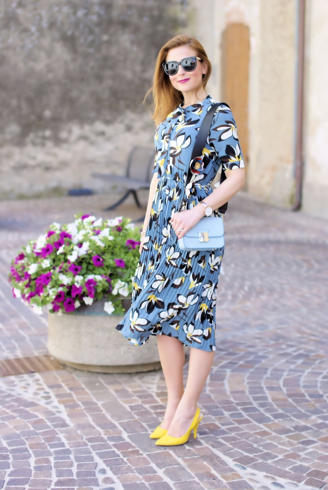Modest outfit idea with a floral pleated midi dress from Metisu on Fashion and Cookies fashion blog, fashion blogger style