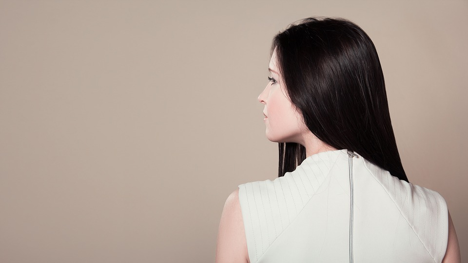 woman-from-behind-with-long-hair Pixabay image illustrating How to Prevent Hair From Revealing Your Age