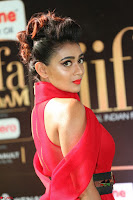 Apoorva in a Stunning Tight Leg Split Sleeveless Red Gown at IIFA Utsavam Awards 003.JPG
