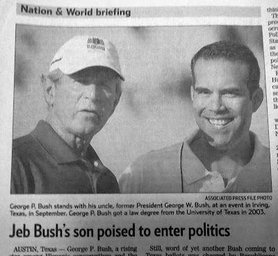 Newspaper clipping wiht photo of George W. Bush with his nephew George P. Bush (son of Jeb Bush), who plans to run for office