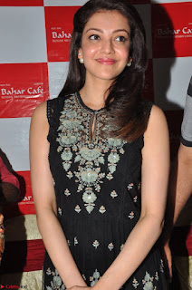Kajal Aggarwal in lovely Black Sleeveless Anarlaki Dress in Hyderabad at Launch of Bahar Cafe at Madinaguda 039.JPG