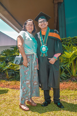 Our client wearing the graduation rosette lei made for his graduation in Polytechnic University of the Philippines