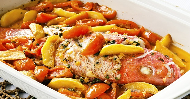 Baked Garlic Fish With Tomatoes And Potato Wedges Recipe