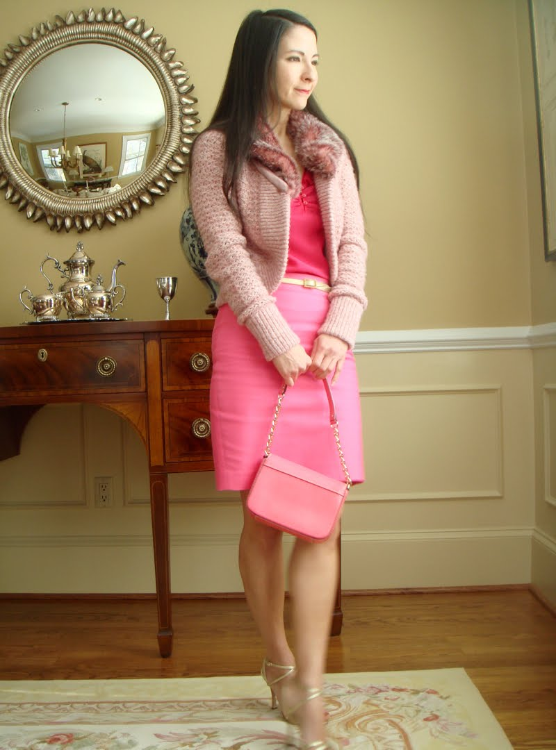 Valentine's Day Outfit full body holding bright pink purse and wearing gold strappy shoes.